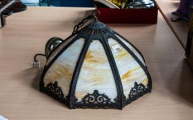 American Reproduction Glass Hanging Light Shade with eight shaped brown glass panels;