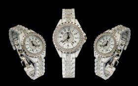 Chanel J12 Date-Just White Ceramic Stone Set Quartz Wrist Watch. Serial No Z.G.58096.