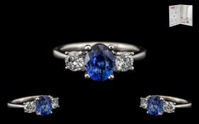 18ct White Gold Stunning 3 Stone Sapphire and Diamond Set Dress Ring the central natural corundum
