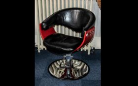 Black Leatherette Tub Chair on Chrome Base, barber style chair by Spindle, in black with red trim.