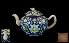 A Small Chinese Teapot in the Famille Rose decoration, Republic period. Character marks to base.
