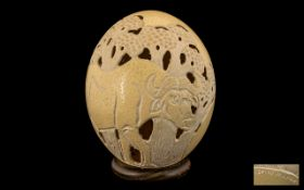 Large Antique Carved Ostrich Egg. Large Ostrich Egg with water buffalo carving, signed to bottom.