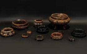 Collection of Chinese Wooded Stands. Various shapes and sizes, 12 in total.
