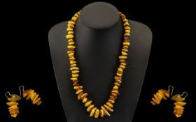 A Modern Reconstituted Amber Free form Necklace. Length 22 inches. Together with a pair of amber
