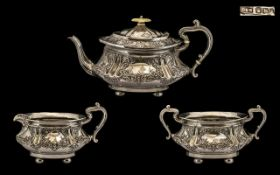 Victorian Period Elaborately Decorated 3 Piece Silver Tea Service of Excellent Form and Quality.