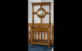 Edwardian Oak Hallstand with a small central mirror flanked by coat hooks,