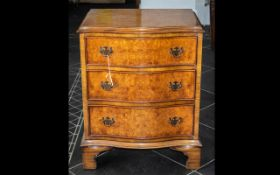 A Reproduction Small Serpentine Fronted Chest of Three Drawers in burr walnut,
