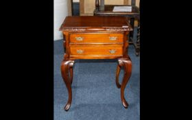 Reproduction Mahogany Side Table with two drawers, supported on claw and ball cabriole legs,