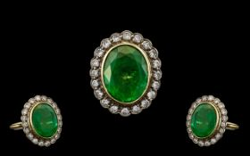 A Stunning 18ct Gold Emerald and Diamond Set Dress Ring of Top Quality, From the 1950's. The Central