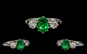18ct White Gold Excellent Quality & Attractive Emerald & Diamond Set 3 Stone Ring.