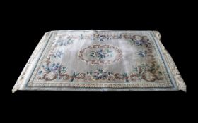 Persian Style Traditional Rug in pale green with floral decoration and central pattern,