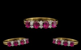 18ct Gold Attractive Ruby & Diamond Set Dress Ring. The four rubies with six diamond spacers. The