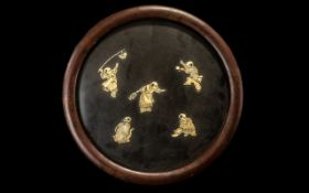 A Japanese Round Lacquered Wall Plaque with applied carved figures in bone of boys playing various