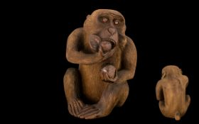 Japanese Meiji Period Carving of a Monkey Eating a Peach, of unusually large size, with finely