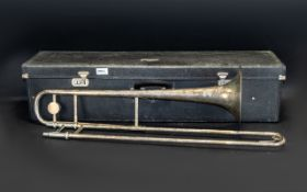 A Selmer Invicta Silver Trombone numbered 11938. Odd dings. Lacking mouthpiece. Housed in a