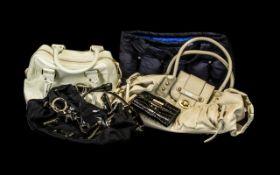 Collection of Fashion Handbags comprising black fabric and patent Guess handbag;