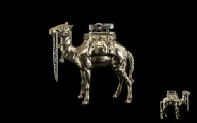 1930s Chromed Metal Petrol Cigarette Lighter in the form of a standing camel; 5 inches high x 5