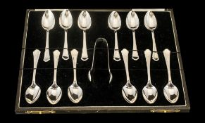 A Boxed Set of 12 Silver Coffee Spoons together with matching sugar tongs. Hallmarked for Birmingham