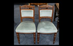 A Pair of Edwardian Oak Salon Chairs with turned legs, upholstered in blue velour back and seat.
