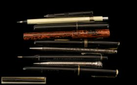 A Collection of Early 20th Century Fountain Pens, comprising: 1. Swan Self-Filling rubber cased