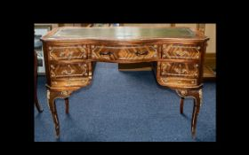 A French Style Serpentine Writing Desk Mid to Late 20th Century green leather top above central
