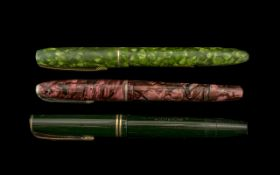Collection of Three Parker Pens comprising a pink marbled effect Parker pen with 14ct gold nib;