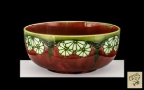 Minton Secessionist No 32 Large and Impressive Tubelined Footed Bowl, c1890, in ruby red colour with