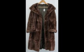 Ladies Musquash Coat in rich brown colour, with shawl collar and turn back cuffs,
