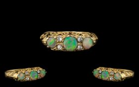 Antique Period 9ct Gold Attractive 3 Stone Opal & Diamond Set Ring. Full hallmark for 9ct. Opals