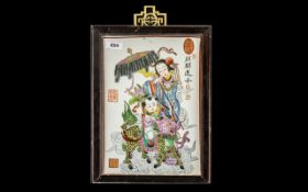 Chinese 20thC Painted Tile Picture depicting a child riding a Kylin with a consort; fully signed