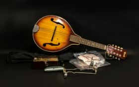 An 8 String Banjo marked Terado. Together with A music sheet stand, a Metronome, various strings,