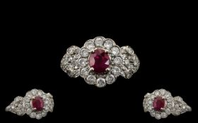 Ladies Attractive 18ct White Gold Ruby and Diamond Set Stylish Cluster Ring, the central ruby