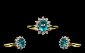 18ct Gold Attractive Pleasing Diamond and Aquamarine Set Cluster Ring, full hallmark for 18ct; the