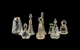 A Collection of Eight Cut Glass Mostly Scent Bottles some with silver collars A/F. The tallest