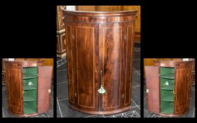 A Georgian Mahogany Double Door Inlaid Corner Cupboard with fitted shelves to the interior and a