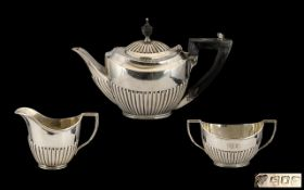 Edwardian Period Silver Three-Piece Bachelor Tea Service of small proportions.