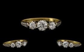 18ct Gold and Platinum Attractive Three Stone Diamond Set Ring, marked 18ct gold and platinum, the