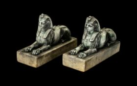 Pair of Antique Bronze Regency Period Egyptian Sphinx on white marble bases,