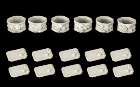 Twelve Porcelain Menu Holders in card box (unused), with six porcelain napkin rings in card box (