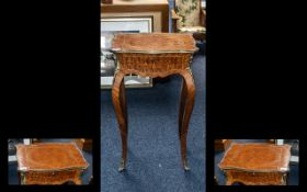 A Small French Style Kingswood Side Table Mid to Late 20th Century of shaped form, frieze drawer