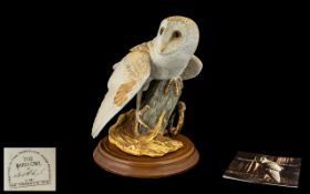 Franklin Mint 'The Barn Owl' Figure raised on a wooden base, with original documents. Measures 9.
