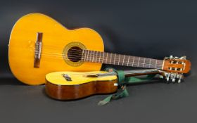 A Factory Made Acoustic Guitar with paper label that reads 'Made in Spain'. Together with a Child'