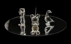Collection of Three Swarovski Figures, a