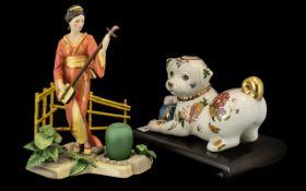 Two Porcelain Figures comprising a decor