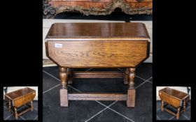 Small Oak Reproduction Drop Leaf Table on turned legs; approx.