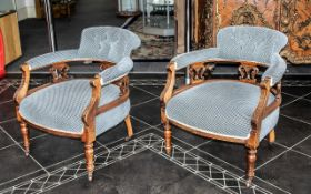 A Pair of Victorian Tub Chairs with padded back rests, arms and seats.