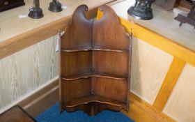 A Sheraton Style Walnut Corner Shelf Unit broken pediment above three shelves between reeded
