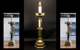 A Gothic Antique Brass Converted Candlestick Lamp of typical form, Measures 30 inches hight.