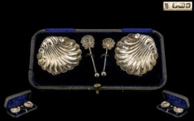Victorian Period Boxed Pair of Silver Salts and Matching Spoons of Shell Design / Form.