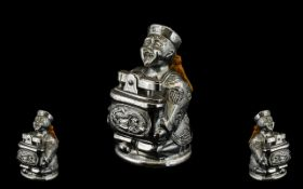 Unusual 1930s Chromed Metal Petrol Cigarette Lighter in the form of a seated Chinese Mandarin,